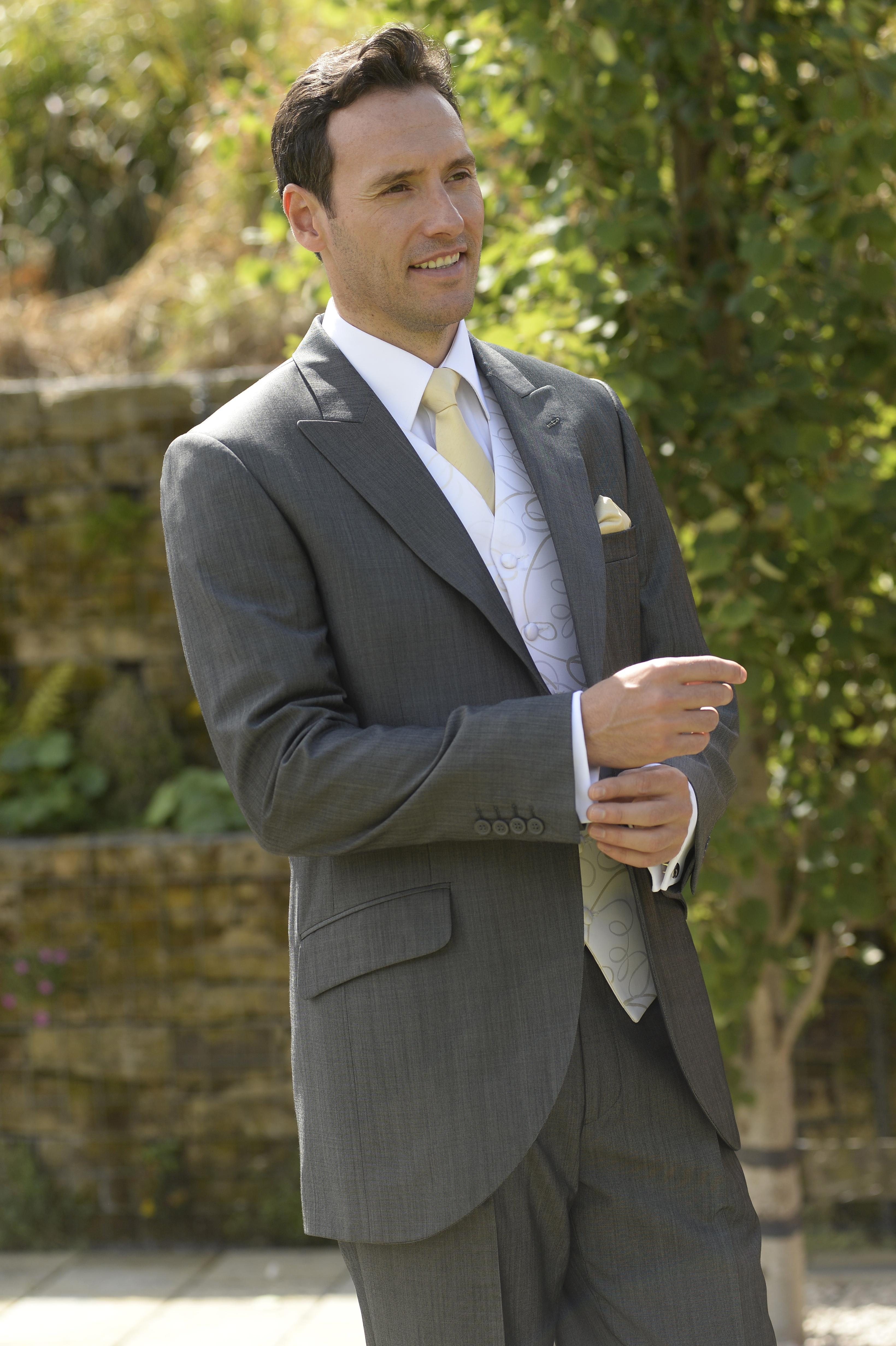 Silk Grey short jacket with Champagne waistcoat and gold tie and handkerchief